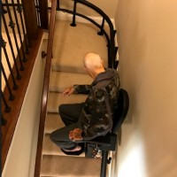 Lifeway-Mobility-Minnesota-customer-riding-his-new-Harmar-Helix-curved-stairlift.JPG