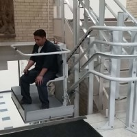 Man-riding-inclined-platform-lift-installed-by-Lifeway-Chicagoland.jpg