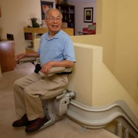 Older-man-riding-Bruno-Elite-Indoor-Curve-stairlift.JPG