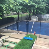 Protect A Child mesh pool fence around clear-covered pool installed by Lifeway Mobility Indiana
