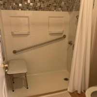 accesible-shower-in-Indianapolis-area-home-with-diagonal-grab-bar-and-shower-bench.jpg