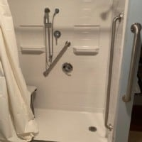 barrier-free-shower-with-grab-bars-and-in-wall-shower-niches.JPG