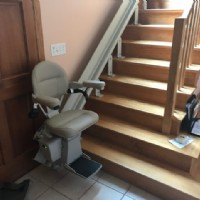 curved-stairlift-at-bottom-landing-in-home-in-Framingham-Mass.jpg