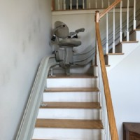 curved-stairlift-halfway-up-staircase-in-home-in-Massachusetts.jpg