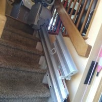 manual-folding-rail-for-stairlift-flipped-up-to-remove-tripping-hazard.jpg