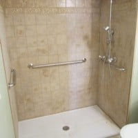 wheelchair-accessible-shower-with-rubber-threshold-and-grab-bars.jpg