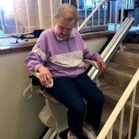 woman-riding-new-Harmar-SL600-stair-lift-in-home-in-St.-Paul.JPG