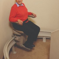 woman-riding-on-Bruno-curved-rail-stairlift.JPG
