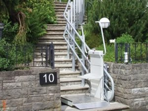 Inclined Platform Lift installed on an outdoor staircase