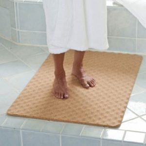 Image of a senior standing on a slip-resistant bathroom floor mat
