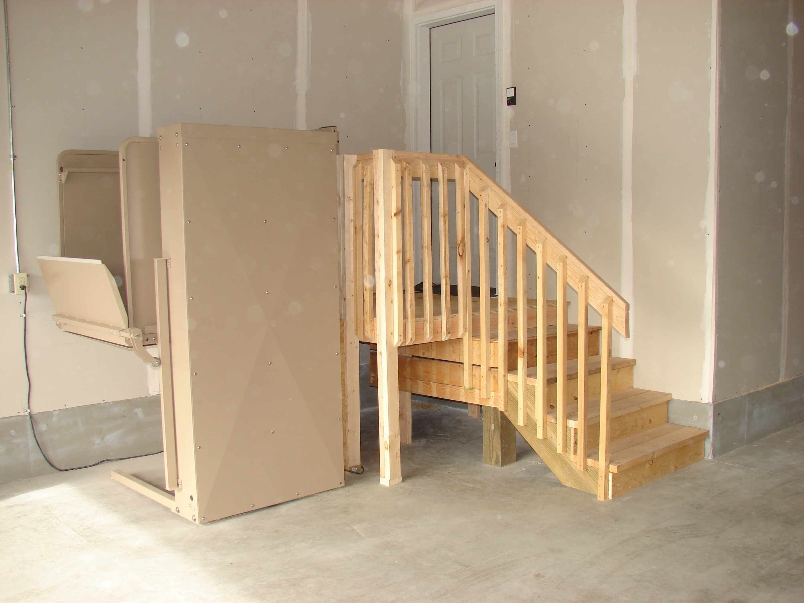 Wheelchair Ramp or Vertical Platform Lift: Which is Right ... on home elevator door, home elevator steps, home elevator lights, home elevator winch, home elevator garage, home elevator lift, home elevator shaft, home elevator rail,