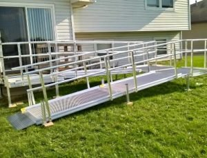 Image of an Aluminum Modular Wheelchair Ramp installed in the backyard of a home in Joliet, Illinois
